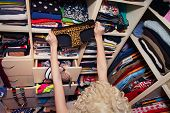 Getting dressed concept woman  in walk in closet choosing underwear