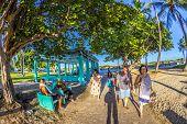 People Enjoy Walking Along The Ocean Drive
