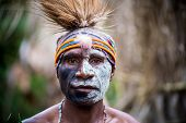 PAPUA NEW GUINEA - OCTOBER 25: A Kaia Tribe member in traditional clothing and face paint in Kaip Vi