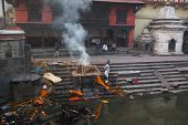 KATHMANDU, NEPAL - DEC 20: During the cremation ceremony along the holy Bagmati River in Bhasmeshvar