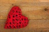 picture of heartfelt  - Red heart on a background of wood - JPG