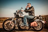 MOSCOW, RUSSIA-JULY 7, 2013: Biker on Legendary bike Harley Sportster. Harley-Davidson sustains a la