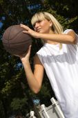 Girl Playing Basketball Outside