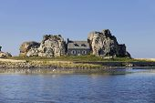 famous house on the rocks at ploumenach, cote de granit rose, cotes d'armor brittany, france