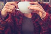 Woman In Wool Jumper Drinking Coffee On Cold Day