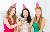 celebration, drinks, friends, bachelorette party, birthday concept - three smiling women wearing pin