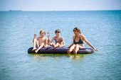 Happy family having fun on air bed
