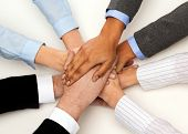 business, succcess and winning concept - group of businesspeople celebrating victory