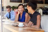 Two Businesswomen Meeting In Coffee Shop