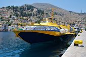 SYMI, GREECE - JUNE 19, 2011: Hydrofoil ferry Aegean Prince II docked in Yialos harbor on the Greek island of Symi. The Greek registered vessel was built in Georgia in 1981.