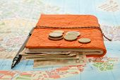 image of coins  - Close-up Travel Arrangement of Euro money, Map and notepad diary