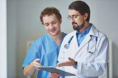Portrait of two clinicians in uniform working in team