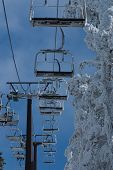 Ski chair lift with skiers. Ski resort in navacerrada spain,