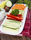 picture of crudites  - Different Vegetables with fresh made Dip on dark wooden background - JPG