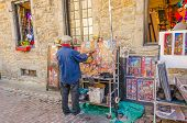 MONTREAL, CANADA, OCTOBER 12, 2013 - artist painting and selling his art in the street of Old Montre