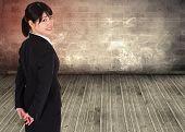 Smiling businesswoman against grimy room