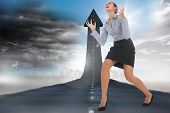 Furious businesswoman gesturing against road turning into arrow