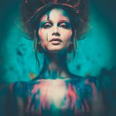 stock photo of diva  - Young woman muse with creative body art and hairdo - JPG
