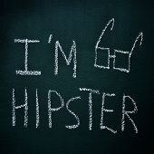 sentence I am hipster written with chalk in a chalkboard