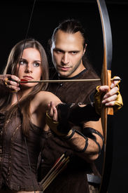 image of longbow  - Young couple has some dangerous hobby - JPG