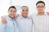 Southeast Asian business team in office.
