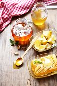 Fresh honey and sliced lemon on wooden table