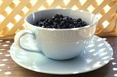 Useful blueberry in bowl on table, close-up