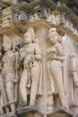 stock photo of kandariya mahadeva temple  - Apsaras ladies of the court preening and posing Kandariya Mahadeva Temple at Khajuraho India - JPG