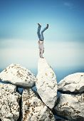 acrobat man on huge rock