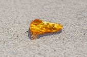 amber with inclusions on sand