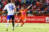 Sisaket Thailand-july 23: Brent Mcgrath Of Sisaket Fc. (orange) Shooting Ball During Thai Premier Le