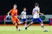 Sisaket Thailand-july 23: Brent Mcgrath Of Sisaket Fc. (orange) In Action During Thai Premier League
