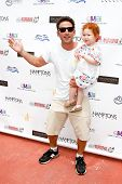 BRIDGEHAMPTON, NY-JUL 19: Mark Feuerstein (L) & his niece Lily Rae Feuerstein attend the 6th Annual