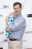 BRIDGEHAMPTON, NY-JUL 19: CMEE Executive Director Stephen Long (R) & son Bennett attend the Annual Family Fair at Children's Museum of the East End (CMEE) on July 19, 2014 in Bridgehampton, New York.