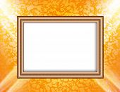 Blank frame on a colored wall lighting spotlights
