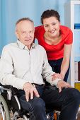 Smiling Disabled Man And Nurse