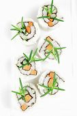 Maki Sushi - California Roll with Cucumber , Cream Cheese and Raw Salmon inside. Served with wasabi
