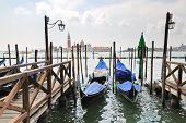 Gondolas And View San Giorgio Maggiore In Venice