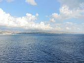 pic of messina  - Calabria Italy coastline from Strait of Messina in summer day - JPG