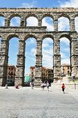 Tourist Near Aqueduct Of Segovia, Spain