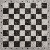 vintage crack old scratched empty chess board. abstract grunge background
