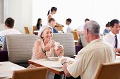 Senior Couple Enjoying Breakfast In Hotel Restaurant