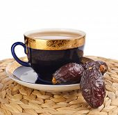 Black coffee with dates - a middle eastern refreshment drink  isolated  on a white background