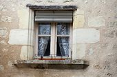 pic of engadine  - the old window with beautifully adorned curtains - JPG