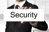 Businessman Holding Sign Security