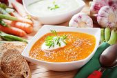 Creamy carrot soup with cream and toasted bread