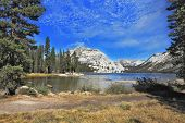 Gorgeous American nature. The majestic Lake Tioga in a hollow among the mountains famous Yosemite Na