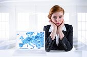 Redhead businesswoman looking unhappy with laptop showing graphic