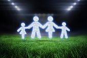 Cloud in shape of family against football pitch with bright lights