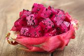 image of dragon fruit  - Close up of dragon fruit on wooden surface - JPG